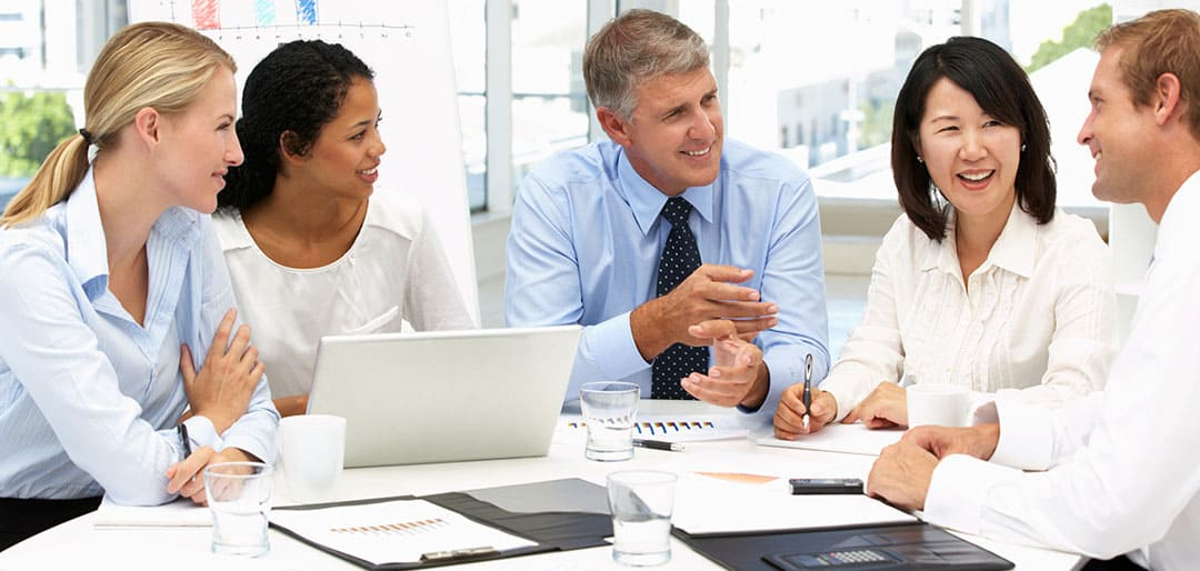 Happy group of businesspeople during office meeting